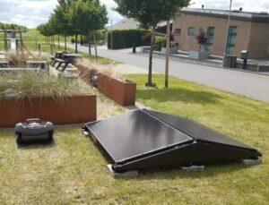 Solcellelader til robotplæneklipper